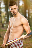 Sexy man with axe Royalty Free Stock Image