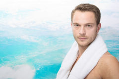Sexy man on beach Stock Images