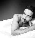 Sexy man in bed Royalty Free Stock Photography