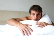 Man on the Bed Stock Images