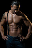 man with black suspenders over naked chest Royalty Free Stock Image