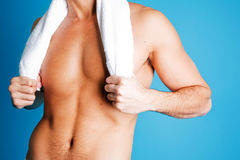 Sexy man body. Sexy fit man body against blue background Stock Photos