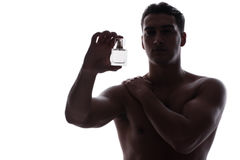 The sexy man with bottle of perfume Stock Images