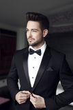 Sexy man celebrity in tuxedo indoor Royalty Free Stock Images