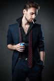 Sexy man with a cigarette and a drink in a tin Stock Photo