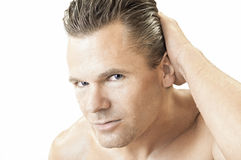Man. Closeup portrait of handsome shirtless man with wanting eyes and wet skin running hand over wet hair on white background royalty free stock photo