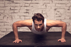 Sexy man is doing exercise. Royalty Free Stock Photos