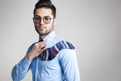 Sexy man dressed elegant with s sock tie looking serious Royalty Free Stock Images