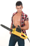 Sexy man with electrical saw Stock Images