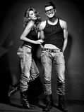 Sexy man en vrouw die een spruit van de manierfoto doen Stock Foto