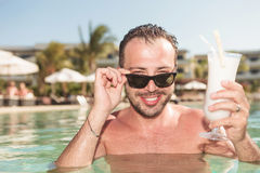 Sexy man enjoying a cold cocktail Royalty Free Stock Photo