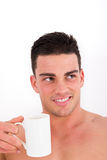 Sexy man enjoying cup of coffee in the morning Stock Images