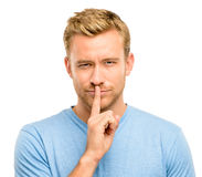 Sexy man with finger on lips Stock Photography