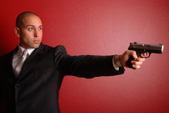 Sexy man with gun. Royalty Free Stock Photography