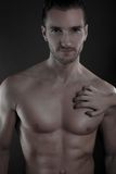 Sexy man with the hand of a woman posed on his torso Royalty Free Stock Photo