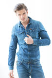 Sexy man in jeans casual clothes holding his shirt Royalty Free Stock Image