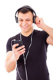 Sexy man listening mp3 player with headphones Stock Images