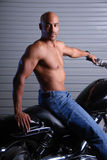 Sexy man on motor cycle. Royalty Free Stock Images