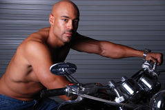 Sexy man on motor cycle. Royalty Free Stock Photos