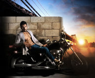 Sexy man on motorcycle Royalty Free Stock Photo