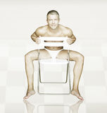 Sexy man. Portrait of a shirtless sexy man sitting on a chair Stock Photos