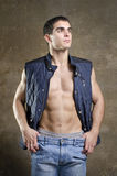 Sexy man posing shirtless with jacket Royalty Free Stock Image
