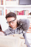 Sexy man reading a book at home Stock Photography