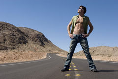Sexy man on road Stock Photos