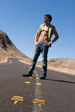 Sexy man on road Royalty Free Stock Image