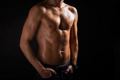 Man's torso. In dark stock photography