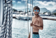 Sexy man on sailboat Stock Image