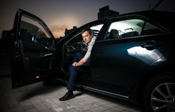 Sexy man sitting in car Stock Photo