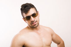 Sexy man. Studio portrait of sexy man with sun glasses Stock Images