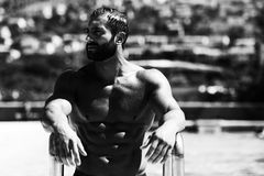 Man In The Swimming Pool. Portrait Of A Wet Muscular Man Standing In Swimming Pool Stock Images