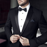 Sexy man in tuxedo and bow tie Stock Photography