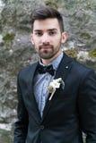 Sexy man in tuxedo posing Stock Photos