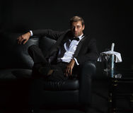 Sexy man in tuxedo waiting for his date Royalty Free Stock Photo