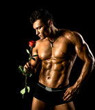 Sexy man. The very muscular handsome sexy guy on black background, naked  torso Stock Photos