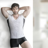 Sexy man. Very sexy young male muscular model in teeshirt and underwear Royalty Free Stock Photos