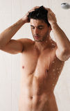 Sexy man washing in bathroom Royalty Free Stock Image