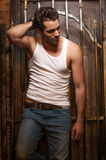 Sexy man in white T-shirt and jeans. Stock Images