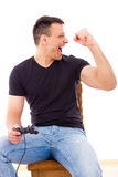 man winning video game playing with joystick Stock Photography