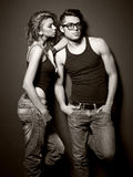 Sexy man and woman doing a fashion photo shoot Stock Images