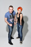 Sexy man and woman doing a fashion photo shoot in a professional studio Stock Images