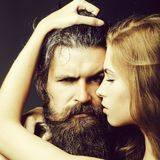 Man and woman embracing. Bearded handsome men and female slim flexible body of young pretty women or girl has long blonde hair embracing stock images