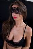 Sexy masked woman in lingerie Royalty Free Stock Image