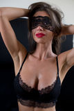 Sexy masked woman in lingerie Royalty Free Stock Photography