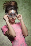 Sexy masquerade woman. Carnival shoot of sexy brunette girl masquerade with silver mask, posing with hair style and pink sexy dress Royalty Free Stock Photo