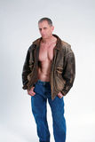 Sexy mature man in leather jacket Royalty Free Stock Images