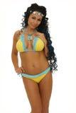 Bikini. Picture of mature woman with yellow and blue bikini stock photography